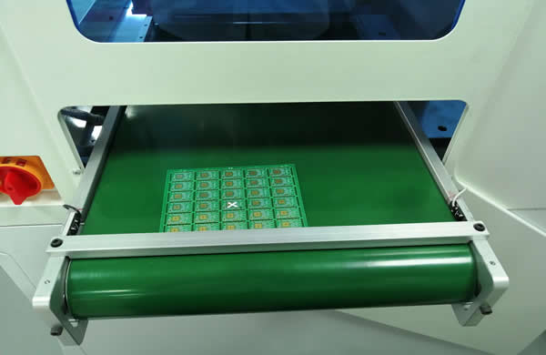 On the bottom of unload conveyor belt.It Include a sensor that can check the PCB out.
