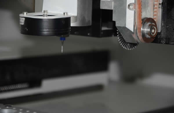 The machine has two z-axes, one is a round cutter installed to cut v-cut slots, the other is a Milling cutter installed to cut stamp holes.